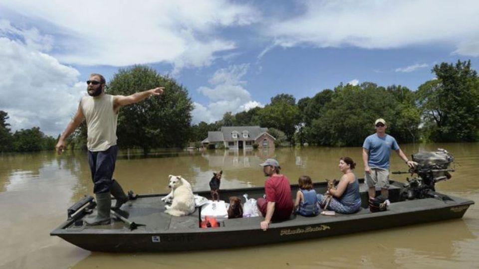 Texas residents searching for the floodwaters hoping to find stranded survivors. Picture: Twitter