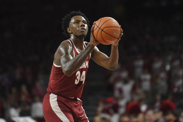 Alabama guard Tevin Mack shoots a free throw against Arkansas during the second half of an NCAA college basketball game, Saturday, March 9, 2019 in Fayetteville, Ark. (AP Photo/Michael Woods)