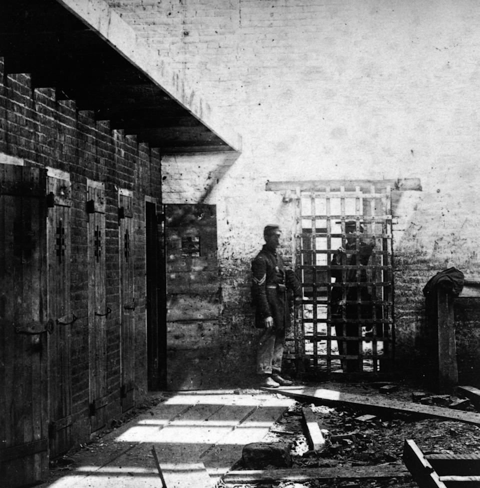 Two soldiers stand beside cells where enslaved Black people were confined in Alexandria, Virginia, circa 1861. (Photo: Archive Photos via Getty Images)