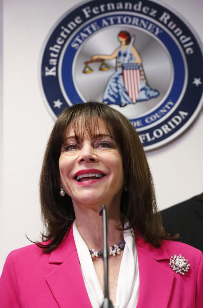 """Miami-Dade State Attorney Katherine Fernandez Rundle smiles as she speaks during a news conference on the arrest of the """"pillowcase rapist"""" responsible for numerous sexual assaults of women in the Miami area during the 1980s, Thursday, Jan. 23, 2020, in Miami. Robert Koehler, 60, was arrested over the weekend in Brevard County and was being held without bond Thursday after his transfer to a Miami jail. (AP Photo/Wilfredo Lee)"""