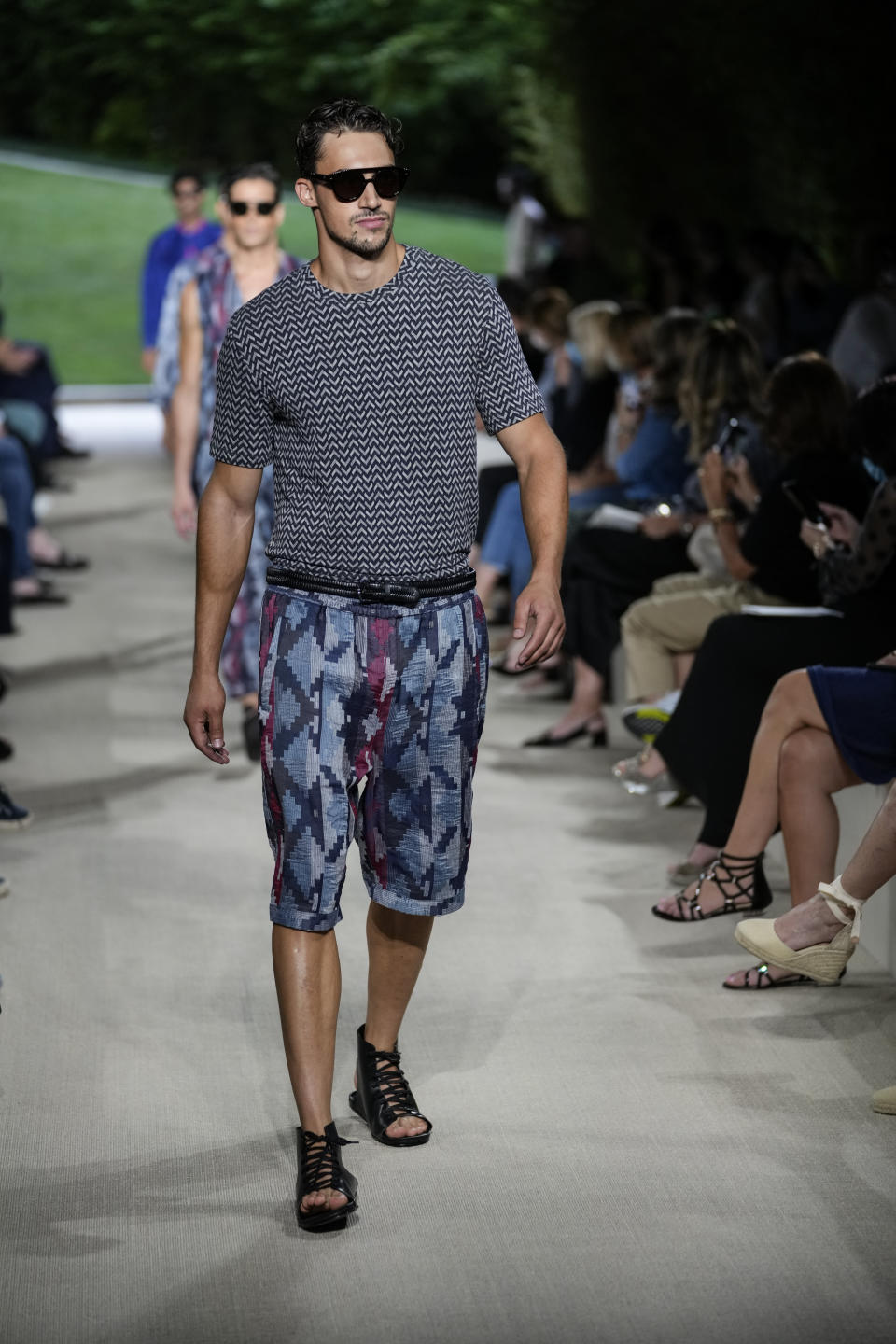 A model wears a creation as part of the Giorgio Armani men's Spring Summer 2022 collection, in Milan, Italy, Monday, June 21, 2021. (AP Photo/Luca Bruno)