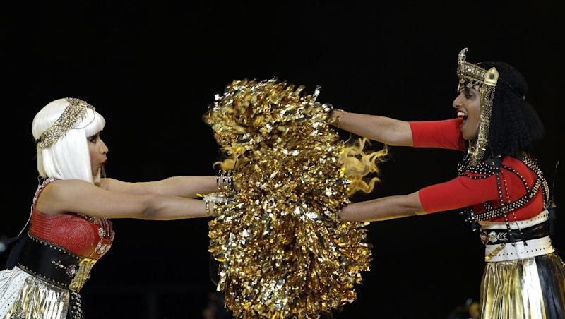 File- This Feb. 5, 2012 file photo shows Nicki Minaj, left, and M.I.A. performing during halftime of the NFL Super Bowl XLVI football game between the New York Giants and the New England Patriots in Indianapolis. M.I.A. says she's been legally harassed by the NFL since she extended a middle finger while performing alongside Madonna at Super Bowl XLVI in 2012. The Hollywood Reporter said Friday that the NFL filed arbitration documents demanding $1.5 million from M.I.A. for breaching her contract and tarnishing the league's reputation. Last week the league asked for summary judgment finding her liable before trial. (AP Photo/David J. Phillip, File)