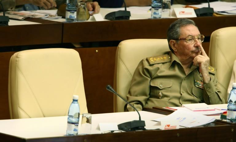 Then interim leader Raul Castro photographed on December 28, 2007 sitting next to the empty seat of his ailing brother, President Fidel Castro