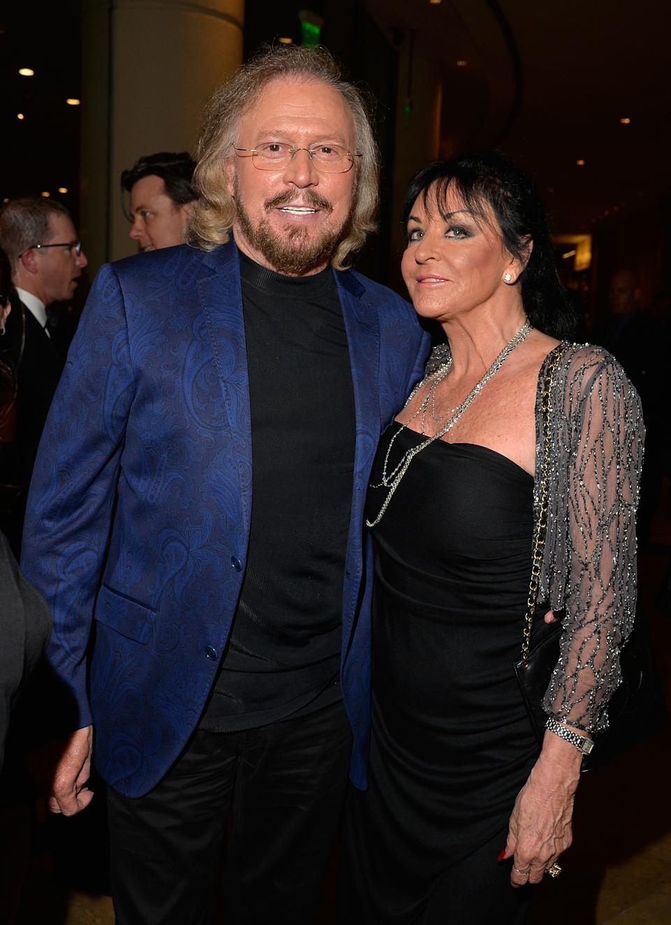 LOS ANGELES, CA - FEBRUARY 07: Recording artist Barry Gibb (L) and Linda Gray attend the Pre-GRAMMY Gala and Salute to Industry Icons honoring Martin Bandier at The Beverly Hilton Hotel on February 7, 2015 in Los Angeles, California. (Photo by Lester Cohen/WireImage)
