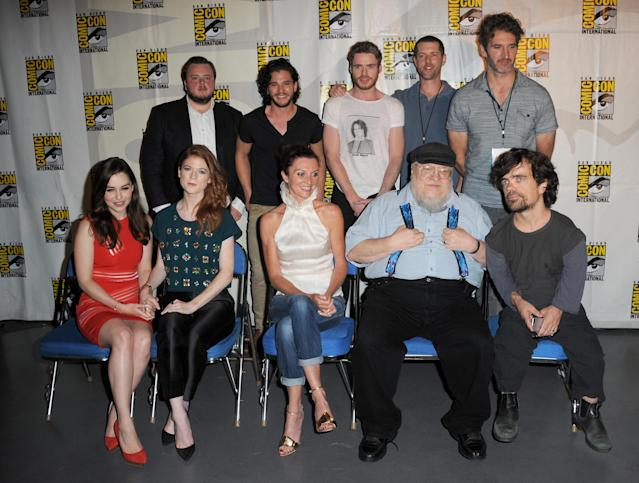 "John Bradley, Kit Harington, Richard Madden, writers D.B. Weiss, and David Benioff, Emilia Clarke, Rose Leslie, Michelle Fairley, writer George R.R. Martin, and actor Peter Dinklage during the ""Game of Thrones"" panel during Comic-Con International 2013 at San Diego Convention Center on July 19, 2013 in San Diego, California."