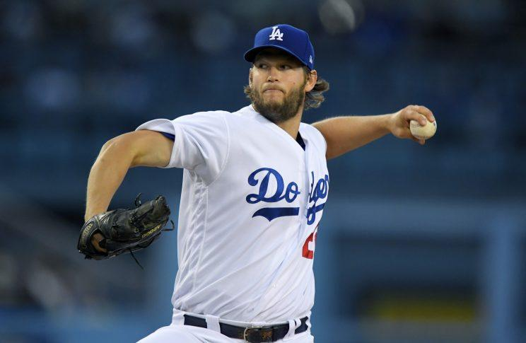 Los Angeles Dodgers starting pitcher Clayton Kershaw winds up during the first inning of the team's baseball game against the Colorado Rockies, Wednesday, April 19, 2017, in Los Angeles. (AP Photo/Mark J. Terrill)
