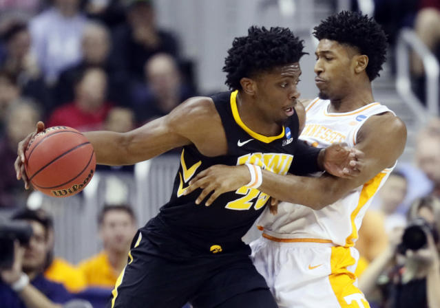 Iowa's Tyler Cook, left, drives past Tennessee's Kyle Alexander in the first half during a second round men's college basketball game in the NCAA Tournament in Columbus, Ohio, Sunday, March 24, 2019. (AP Photo/John Minchillo)