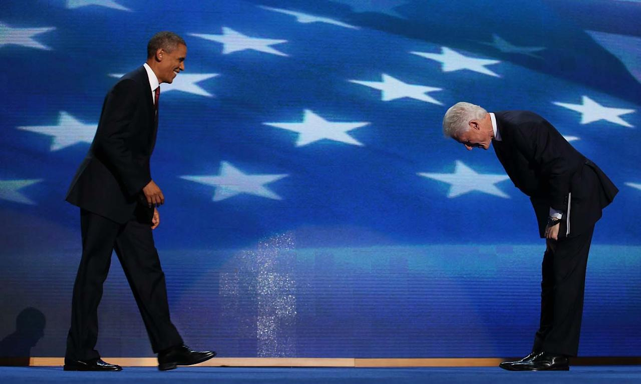CHARLOTTE, NC - SEPTEMBER 05:  Former U.S. President Bill Clinton greets Democratic presidential candidate, U.S. President Barack Obama (L) on stage during day two of the Democratic National Convention at Time Warner Cable Arena on September 5, 2012 in Charlotte, North Carolina. The DNC that will run through September 7, will nominate U.S. President Barack Obama as the Democratic presidential candidate.  (Photo by Chip Somodevilla/Getty Images)