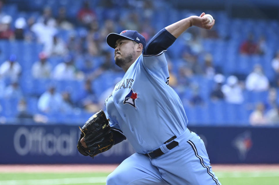 Toronto Blue Jays' Hyun Jin Ryu pitches in the first inning of a baseball game against the Detroit Tigers in Toronto, Saturday, Aug. 21, 2021. (Jon Blacker/The Canadian Press via AP)