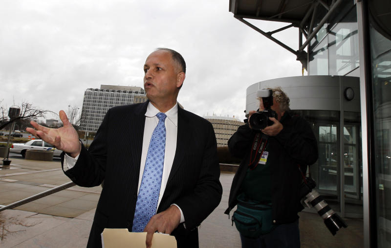 Aref Assaf, left, president of the American Arab Forum, arrives for a meeting with federal and state law enforcement officials at the Richard Hughes Justice Complex in Trenton, N.J. on Saturday, March 3, 2012 to discuss New Jersey's response to the NYPD's secret surveillance program. (AP Photo/Alex Brandon)