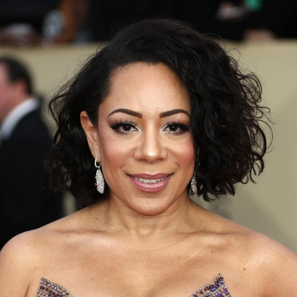 """We're always here for a playful, messy bob. What we like most is although this is a blunt cut, <em>Orange Is the New Black</em> star Selenis Leyva's ends look really healthy, preserving her wave and body. """"This is a beautiful chin-length bob with top layers to lighten it up,"""" says Potempa. """"The blunt cut creates a statement and gives your curls something to naturally fall on. I also love the heavy side part, which was cut bluntly to match the other side."""""""