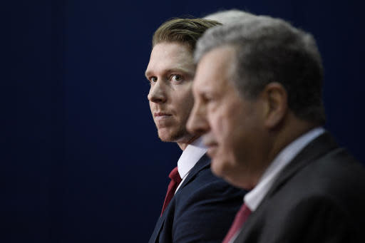 Washington Capitals center Nicklas Backstrom, of Sweden, looks on at an NHL hockey news conference about the Capitals re-signing him to a five-year contract, Tuesday, Jan. 14, 2020, in Washington. (AP Photo/Nick Wass)