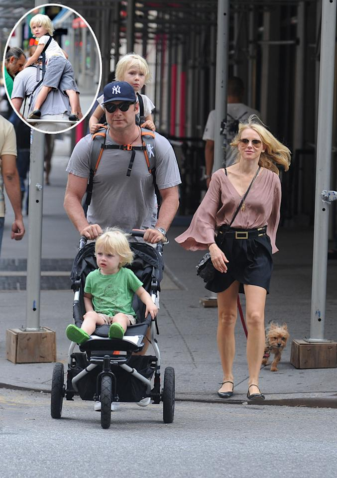 """Could this family be any cuter? Actors Naomi Watts and Liev Schreiber carted their two sons, Kai, who turns 3 in December (in stroller), and 4-year-old Sasha, around New York -- the city the couple now calls home -- on Monday. Naomi was gearing up for a big weekend. Her new film, the thriller """"Dream House,"""" premiered Friday, September 30. Hector Vallenilla/<a href=""""http://www.pacificcoastnews.com/"""" target=""""new"""">PacificCoastNews.com</a> - September 26, 2011"""