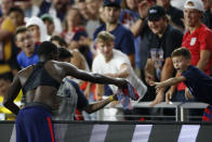 United States' Tim Weah, left, gives his jersey to a fan as he leaves the World Cup qualifying soccer match against Costa Rica during the second half Wednesday, Oct. 13, 2021, in Columbus, Ohio. The United States won 2-1. (AP Photo/Jay LaPrete)