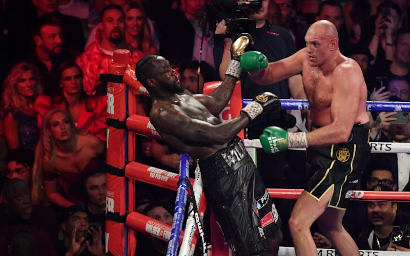 British boxer Tyson Fury (R) has US boxer Deontay Wilder against the ropes before defeating him in the seventh round during their World Boxing Council (WBC) Heavyweight Championship Title boxing match at the MGM Grand Garden Arena in Las Vegas on February 22, 2020 - AFP