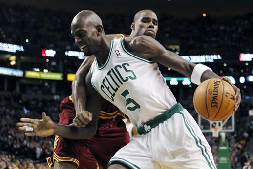 Boston Celtics' Kevin Garnett (5) drives past Cleveland Cavaliers' Antawn Jamison in the first quarter of an NBA basketball game in Boston, Sunday, Jan. 29, 2012. (AP Photo/Michael Dwyer)