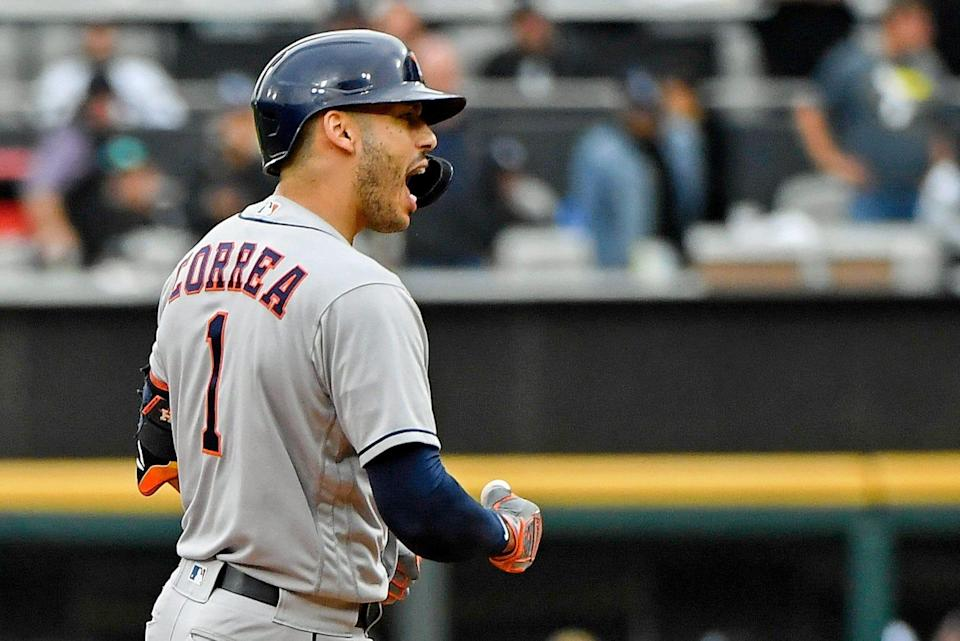 Carlos Correa reacts after a two-run double in the third inning.