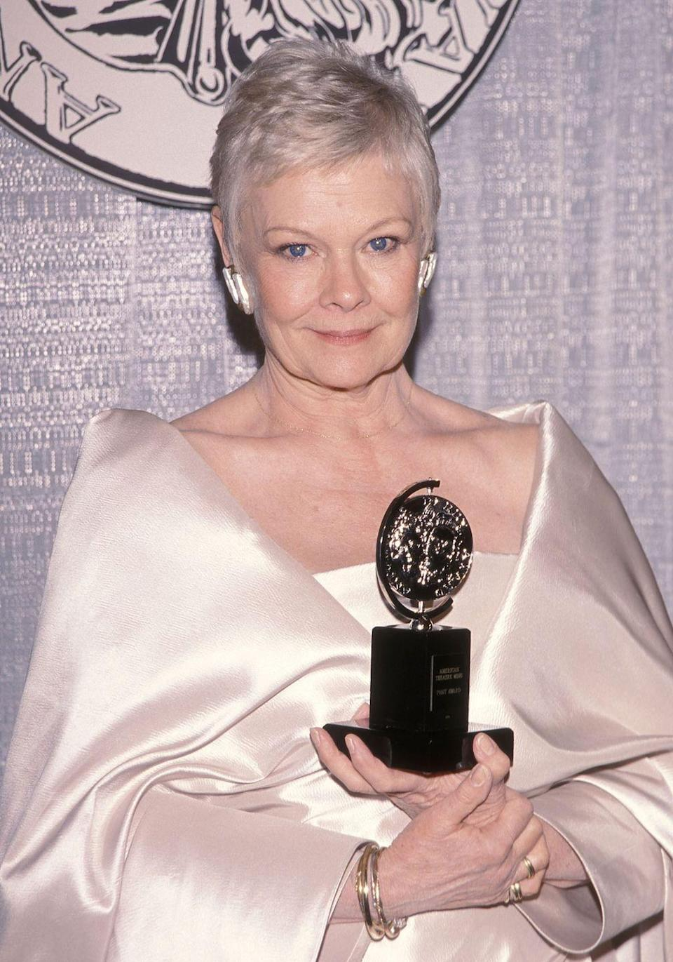 <p>Dench attended the 53rd Annual Tony Awards in New York City and picked up a Tony for Best Actress in a Play for her role in <em>Amy's View.</em><br></p>