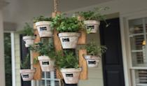 """<p><strong>HangingGardenCo</strong></p><p>etsy.com</p><p><strong>$59.95</strong></p><p><a href=""""https://go.redirectingat.com?id=74968X1596630&url=https%3A%2F%2Fwww.etsy.com%2Flisting%2F502607462%2Fhanging-garden-wooden-planter-indoor-or&sref=https%3A%2F%2Fwww.housebeautiful.com%2Flifestyle%2Fgardening%2Fg1877%2Findoor-herb-gardens%2F"""" rel=""""nofollow noopener"""" target=""""_blank"""" data-ylk=""""slk:BUY NOW"""" class=""""link rapid-noclick-resp"""">BUY NOW</a></p><p>We're loving this twist on the traditional hanging plant basket, that can be used indoors and outside. </p>"""