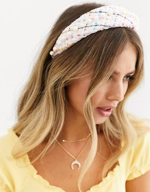 """<p>This <a href=""""https://www.popsugar.com/buy/ASOS-Design-Headband-Pearl-Embellishment-494287?p_name=ASOS%20Design%20Headband%20With%20Pearl%20Embellishment&retailer=asos.com&pid=494287&price=16&evar1=tres%3Auk&evar9=25802428&evar98=https%3A%2F%2Fwww.popsugar.com%2Flove%2Fphoto-gallery%2F25802428%2Fimage%2F46678583%2FASOS-Design-Headband-With-Pearl-Embellishment&list1=gift%20guide%2Cgifts%20for%20women&prop13=api&pdata=1"""" rel=""""nofollow"""" data-shoppable-link=""""1"""" target=""""_blank"""" class=""""ga-track"""" data-ga-category=""""Related"""" data-ga-label=""""https://www.asos.com/us/asos-design/asos-design-padded-headband-in-pink-boucle-with-pearl-embellishment/prd/12958504?clr=pink&amp;colourWayId=16526074&amp;SearchQuery=&amp;cid=4174"""" data-ga-action=""""In-Line Links"""">ASOS Design Headband With Pearl Embellishment</a> ($16) is a great gift for the fashion-forward friend on your list.</p>"""