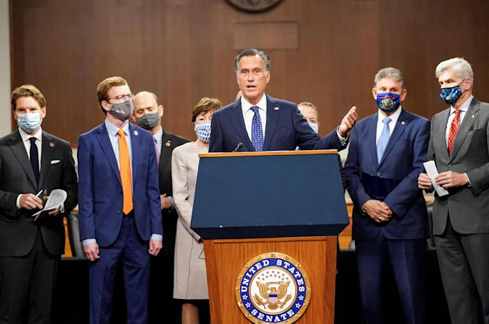 Senator Mitt Romney speaks as bipartisan members of the Senate and House gather to announce a framework for fresh COVID-19 relief legislation at a news conference on Capitol Hill on December 1, 2020. / Credit: KEVIN LAMARQUE / REUTERS