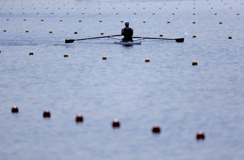 A rower practices before the 2012 Summer Olympics, Tuesday, July 24, 2012, in Eton Dorney, near Windsor. Opening ceremonies for the games will be held Friday, July 27. (AP Photo/Natacha Pisarenko)