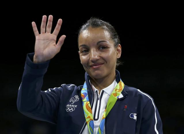 2016 Rio Olympics - Boxing - Victory Ceremony - Women's Fly (51kg) Victory Ceremony - Riocentro - Pavilion 6 - Rio de Janeiro, Brazil - 20/08/2016. Silver medallist Sarah Ourahmoune (FRA) of France gestures. REUTERS/Peter Cziborra FOR EDITORIAL USE ONLY. NOT FOR SALE FOR MARKETING OR ADVERTISING CAMPAIGNS.