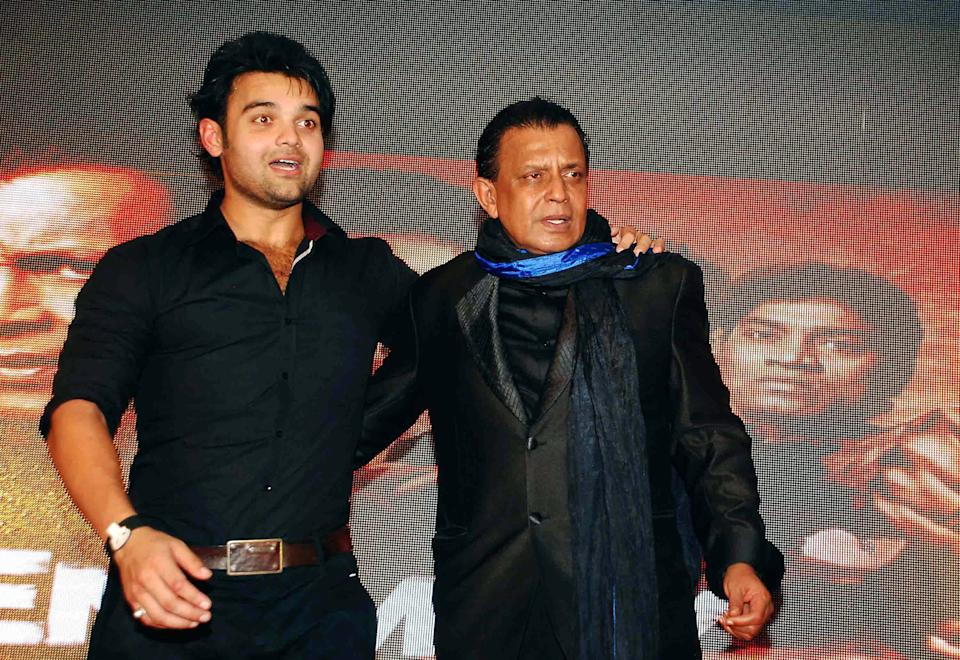 """Indian Bollywood film actors Mithun Chakraborthy (R) and Mahaakshay Chakraborthy pose during the music launch ceremony for the forthcoming Hindi Film """"Enemmy"""" in Mumbai late May 24, 2013.  AFP PHOTO/STR        (Photo credit should read STRDEL/AFP via Getty Images)"""