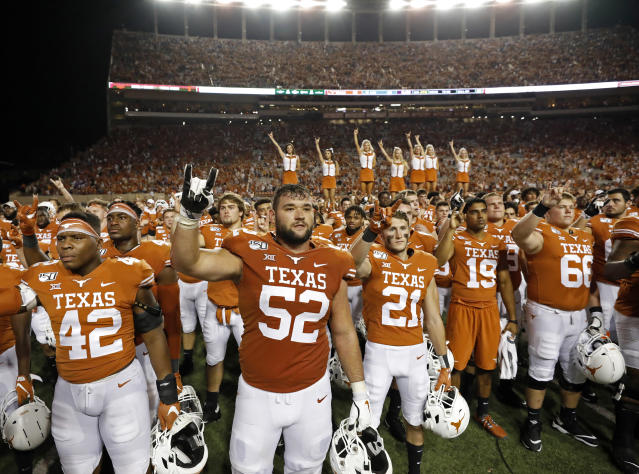 "Texas Longhorns players gather during ""The Eyes of Texas"" after the game with the LSU Tigers Saturday Sept. 7, 2019 at Darrell K Royal-Texas Memorial Stadium in Austin, Tx. LSU won 45-38. ( Photo by Edward A. Ornelas )"