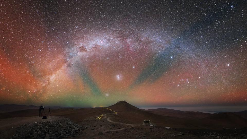The night sky above the European Southern Observatory's (ESO) Paranal Observatory in Chile is ablaze with vibrant airglow in this gorgeous view by astrophotographer Yuri Beletsky. This colorful phenomenon happens because atoms and molecules in Earth's atmosphere interact and emit radiation. For this reason, the sky is never completely dark. Airglow is only visible in places that are far enough from human-made light pollution, like the Paranal Observatory. This image was captured from ESO's Visible and Infrared Survey Telescope for Astronomy (VISTA), and in the distance you can barely see the Very Large Telescope (VLT), which sits on top of Cerro Paranal.