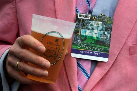 A Masters patron holds a beer during first round play at the 2017 Masters golf tournament at Augusta National Golf Club in Augusta, Georgia, U.S., April 6, 2017. REUTERS/Jonathan Ernst