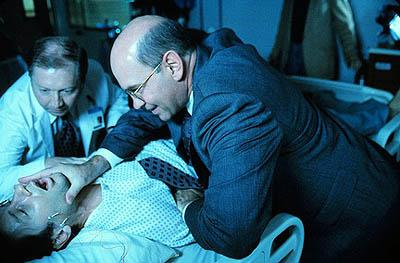"Assistant Director Skinner (Mitch Pileggi) restrains Agent Fox Mulder (David Duchovny) in ""The Sixth Extinction"" episode of Fox's The X-Files X-Files"