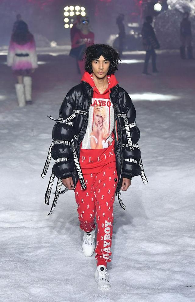 "<p>Model wears a red ""Playboy""-branded sweatshirt and trousers with black puffer jacket at the Philipp Plein FW18 show. (Photo: Getty) </p>"