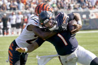 Chicago Bears quarterback Justin Fields (1) carries the ball and is tackled by Cincinnati Bengals cornerback Chidobe Awuzie during the second half of an NFL football game Sunday, Sept. 19, 2021, in Chicago. (AP Photo/Nam Y. Huh)