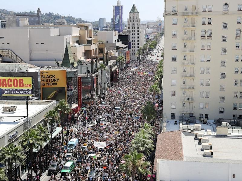 Protesters crowd Hollywood Boulevard during the All Black Lives Matter solidarity march as unrest continues in the wake of the death of George Floyd, on June 14, 2020 in Los Angeles, California.