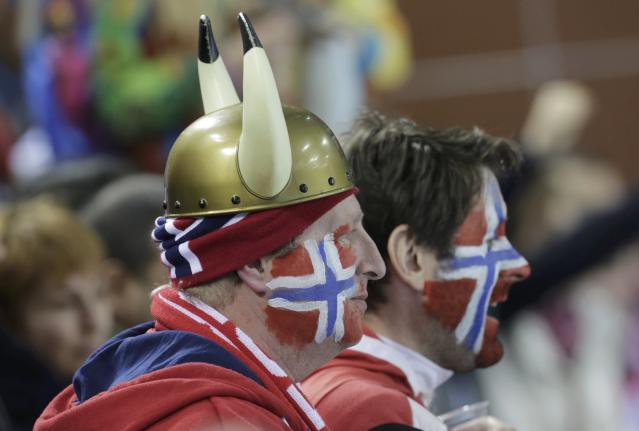 Fans of Norway watch their men's curling round robin game against China in the Ice Cube Curling Centre at the Sochi 2014 Winter Olympic Games February 14, 2014. REUTERS/Ints Kalnins (RUSSIA - Tags: SPORT OLYMPICS SPORT CURLING)