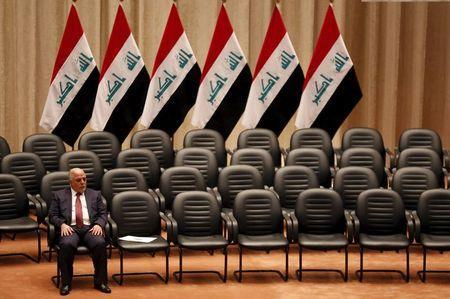 Iraq's new premier Haider al-Abadi sits during a parliamentary session to vote on Iraq's new government at the parliament headquarters in Baghdad, Iraq in this September 8, 2014 file photo. REUTERS/Thaier Al-Sudani/Files