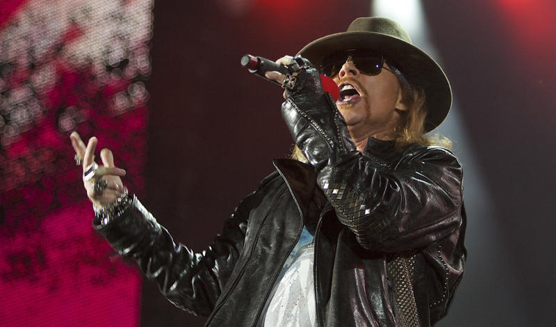 """FILE - In this Dec. 16, 2010 file photo, Axl Rose, lead singer of the rock band, """"Guns N' Roses,"""" performs during a concert on the Yas Island in Abu Dhabi, United Arab Emirates.  The group was nominated for induction into the Rock and Roll Hall of Fame. The Rock and Roll Hall of fame induction ceremony will be held in Cleveland, where the rock hall is based, on April 14. (AP Photo/Nousha Salimi, file)"""