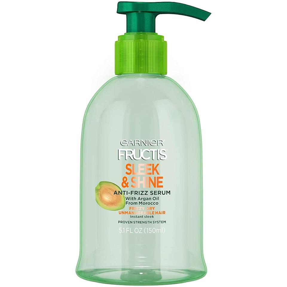 """<p>""""The <span>Garnier Fructis Sleek and Shine Anti-Frizz Serum</span> ($7) is my absolute fave. You can apply on wet or dry hair. It's very lightweight so it will not weigh your hair down. It gives so much shine, helps keep your hair straight, and is a great moisturizing product for your hair. It has amazing oils like moroccan and argon. It works wonders on hair extensions, too."""" - <a href=""""https://www.instagram.com/nafisahcarter/?hl=en"""" class=""""link rapid-noclick-resp"""" rel=""""nofollow noopener"""" target=""""_blank"""" data-ylk=""""slk:Nafisah Carter"""">Nafisah Carter</a>, celebrity hairstylist </p>"""
