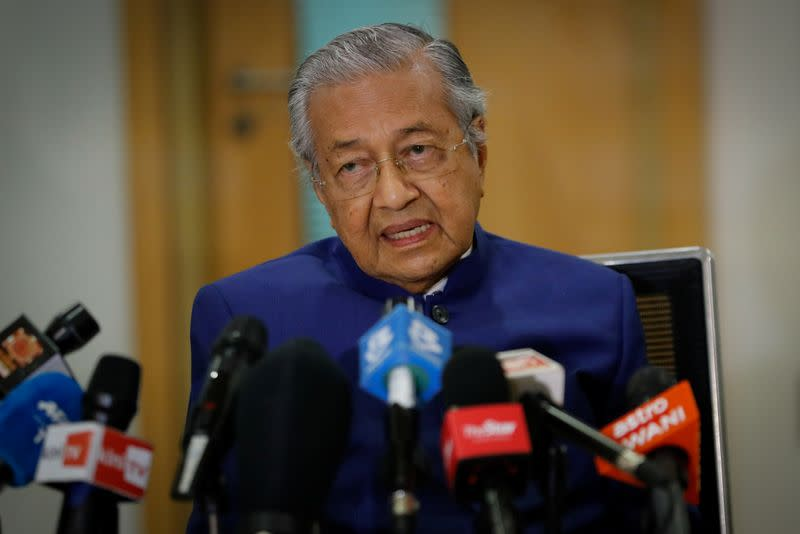 Malaysia's former Prime Minister Mahathir Mohamad speaks during a news conference in Kuala Lumpur