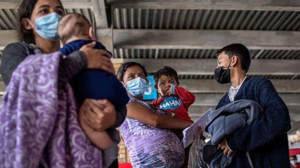 PHOTO: Central American asylum seekers arrive to a bus station after being released by U.S. Border Patrol agents, Feb. 26, 2021, in Brownsville, Texas.  (John Moore/Getty Images)