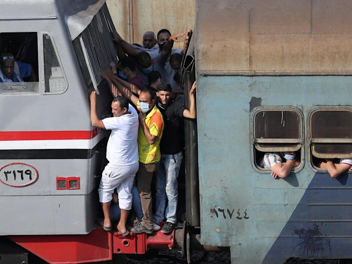 """People travel on an overcrowded train in Cairo, Egypt, on July 9, 2020. <p class=""""copyright"""">REUTERS/Mohamed Abd El Ghany</p>"""