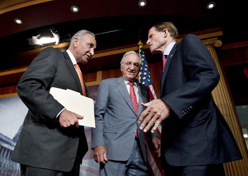 From left: Sen. Charles Schumer, D-N.Y., Sen. Tom Harkin, D-Iowa, and Sen. Richard Blumenthal, D-Conn., confer on Capitol Hill in Washington Tuesday, July 24, 2012, after a news conference where they discussed Democrats and Republican tax proposals.  (AP Photo/Manuel Balce Ceneta)