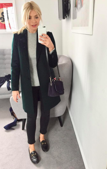 """<p>Now this is hands down one of our all time favourite looks on Holly. The presenter donned her go-to Gucci loafers with a <a rel=""""nofollow noopener"""" href=""""http://www.jigsaw-online.com/product/city-wool-coat/J28215_BK000?utm_source=Affiliate&utm_medium=RakutenAffiliateNetwork&utm_campaign=2116208&utm_content=10&utm_term=UKNetwork&ranMID=35664&ranEAID=TnL5HPStwNw&ranSiteID=TnL5HPStwNw-E.Zp2B1zD5y_337zlEKB3g&utm_campaign=2116208&affiliateID=2116208"""" target=""""_blank"""" data-ylk=""""slk:Jigsaw"""" class=""""link rapid-noclick-resp"""">Jigsaw</a> coat and skinny <a rel=""""nofollow noopener"""" href=""""https://www.donnaida.com/collections/denim/products/rizzo-high-top-ankle-skinny-jeans-blackest"""" target=""""_blank"""" data-ylk=""""slk:jeans"""" class=""""link rapid-noclick-resp"""">jeans</a> by Donna Ida. Talk about smart luxe. </p>"""