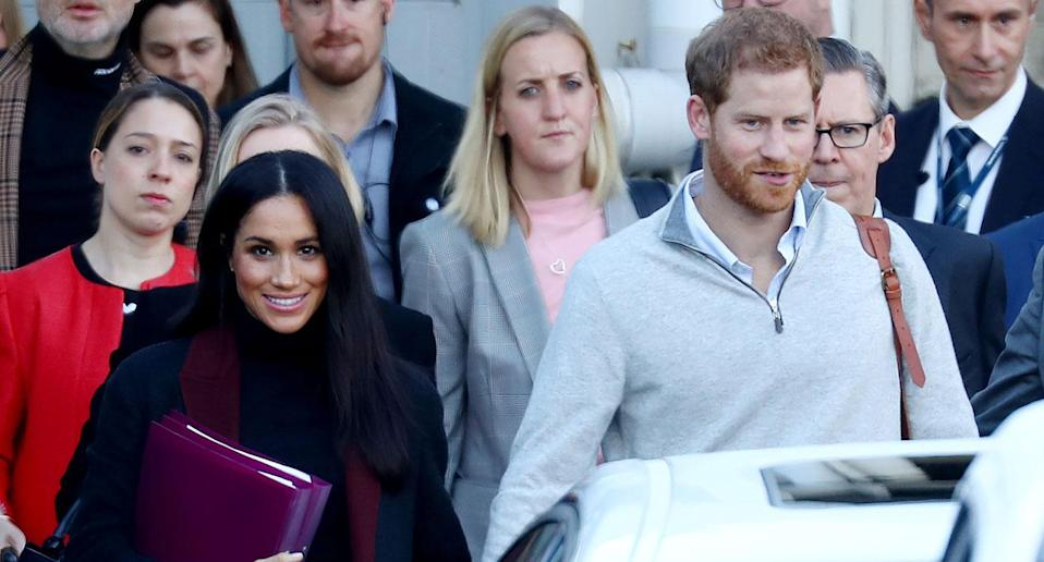 Meghan carried folders as she and Harry landed in Australia (Getty)