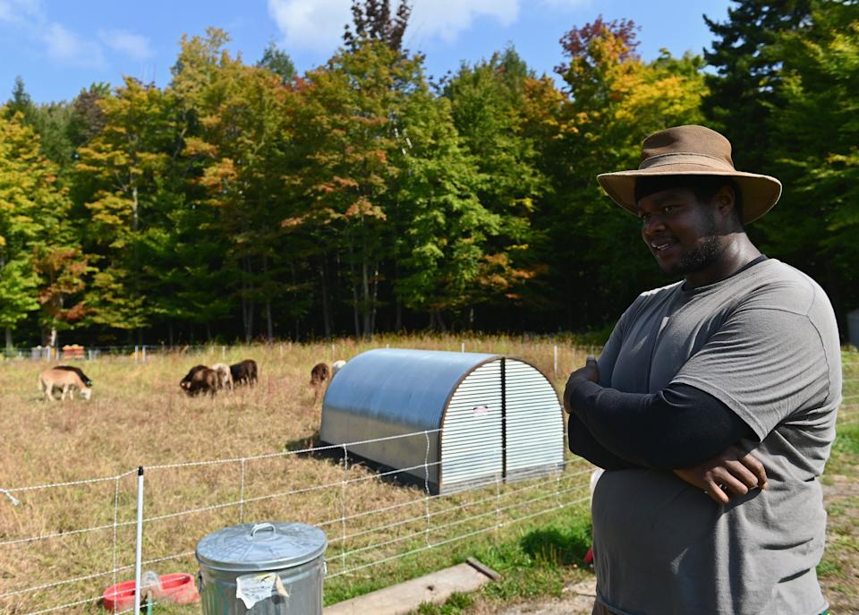 Justin Butts, livestock manager at Soul Fire Farm checks livestock on September 25, 2020 in Petersburg, New York. - While the Black Lives Matter movement has drawn attention to police violence and racism in American cities, racial injustice in the farming sector remains less well-known. Blacks are clearly under-represented on US farms. There are only 45,000 Black farmers -- 1.3 percent of all agricultural producers. Black people are about 13 percent of the population, according to census data. And yet, a century ago nearly 15 percent of American farmers were black, reflecting reforms that followed the end of slavery in the 1860s.  Defining itself as