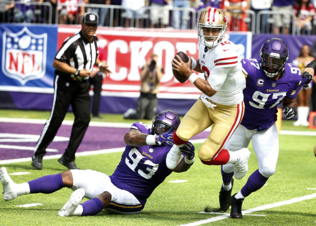 San Francisco 49ers quarterback Jimmy Garoppolo, center, is sacked by Minnesota Vikings defensive tackle Sheldon Richardson (93) and defensive end Everson Griffen (97). (AP)