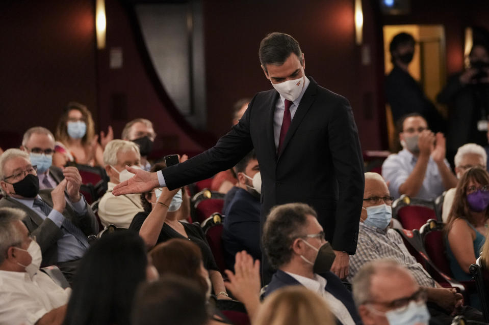 Spain's prime minister Pedro Sanchez walks out after a speech at the Gran Teatre del Liceu in Barcelona, Spain, Monday, June 21, 2021. Sanchez's said Monday that the Spanish Cabinet will approve pardons for nine separatist Catalan politicians and activists imprisoned for their roles in the 2017 push to break away from Spain. (AP Photo/Emilio Morenatti)