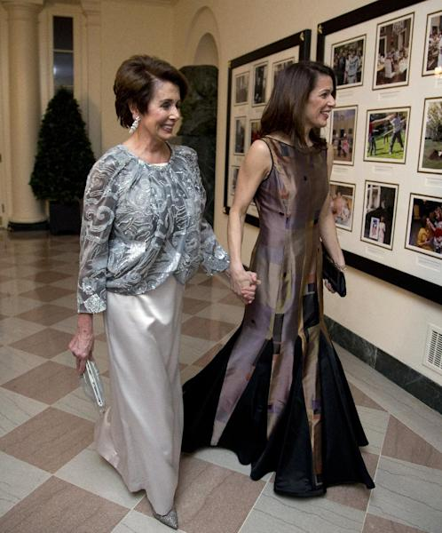 House Democratic Leader Nancy Pelosi, D-Calif., and Jacqueline Kenneally, arrive for a State Dinner in honor of French President François Hollande, at the White House in Washington, Tuesday, Feb. 11, 2014. (AP Photo/Manuel Balce Ceneta)