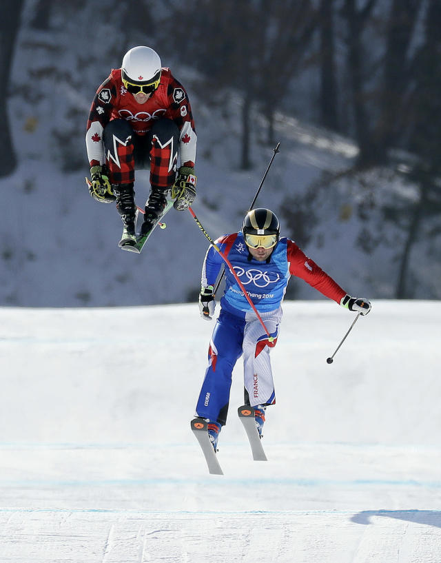 <p>Kevin Drury, of Canada, left, and Arnaud Bovolenta, of France, run the course during the men's ski cross quarterfinal at Phoenix Snow Park at the 2018 Winter Olympics in Pyeongchang, South Korea, Wednesday, Feb. 21, 2018. (AP Photo/Kin Cheung) </p>